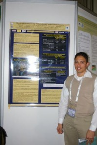 Dominique Pepper stands next to his poster presentation