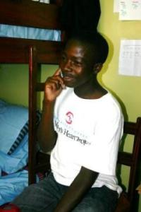 Patrick Kahuma on the phone in Kampala